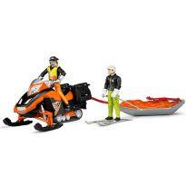 Figurka - Lyžař a záchranář s příslušenstvím + sněžný skútr a saně 63100 BRUDER